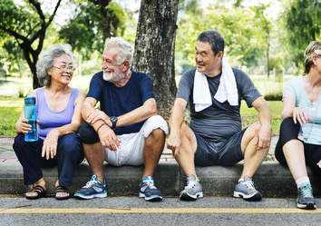 people-of-all-ages-after-exercise-sitting-on-street-curb